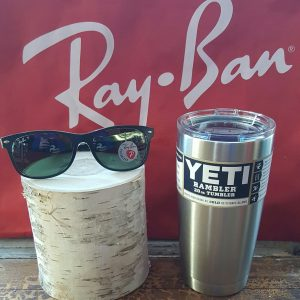 Rayban sunglasses on display with a Yeti Tumbler.