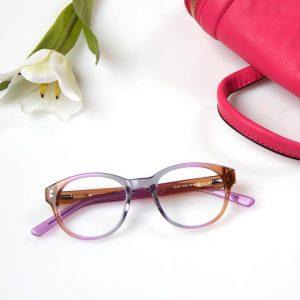 Aspex eyeglasses frames in grey, violet, and ice tea brown.