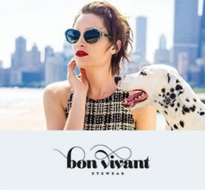 A woman models Bon Vivant sunglasses while sitting outside with her dalmatian with a city in the background.