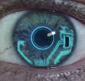 A close up on an eye with a microchip and wiring on it.