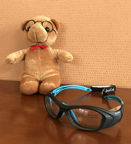 A pair of children's protective eyeglasses for sports.