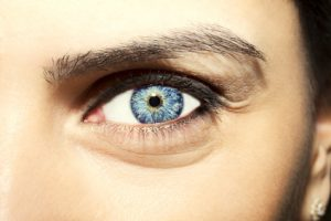 Beautiful insightful look blue woman's eye.