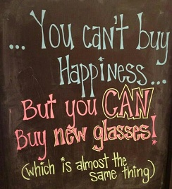 "A sign reads, ""You can't buy happiness but you can buy new glasses! Which is almost the same thing."""