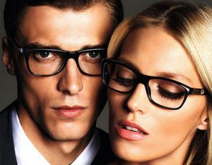 A man and woman each model Gucci Glasses eye glasses available at Relf EyeCare.