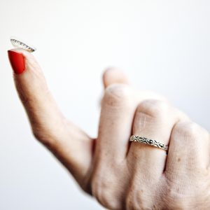 A contact lens on a finger tip