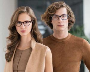 A man and a woman model eyeglasses by Kliik.
