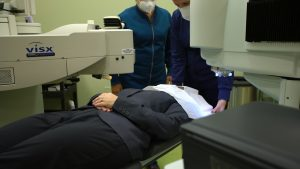 An eye doctor from Relf EyeCare in Duluth, MN performs LASIK on a patient.