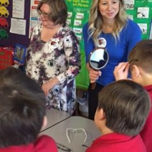 Staff from Relf EyeCare visit with students at Duluth Edison Charter School.