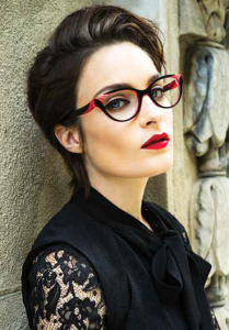 A woman models red and black OGI fashion eyeglasses. Get Ogi and other fashion eyewear at our location in Hermantown.