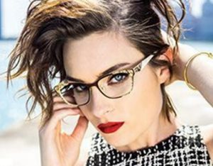 A woman models OGI eye glasses available at Relf Optical.