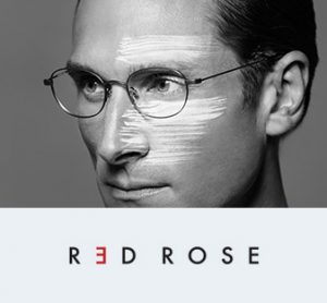 A man models a pair of Red Rose wire eyeglasses in a black and white picture.