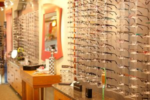 Eyeglasses for the entire family hang on the frame boards at Relf Optical.