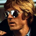 An image of Robert Redford in mirrored lenses sunglasses.