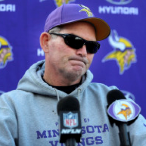 Coach Zimmer of the Minnesota Vikings wears a dark pair of prescription sunglasses.